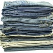 Jeans stacked together on a white background — Stock Photo