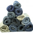 Jeans rolled up stacked in pyramid — Stock Photo