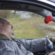 Drunk man asleep in car near highway — Stock Photo