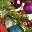 Decorations on the Christmas tree and near the tree — Stock Photo