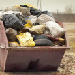 Stock Photo: Garbage bags stacked in container