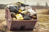 Garbage bags stacked in the container — Stock Photo