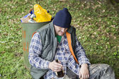 Homeless with botle of drink in hand — Stock Photo