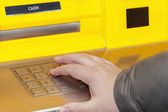 Man's hand near the cash machine on the pin code — Stock Photo