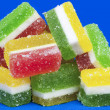 Sweet jelly candies in different colors with sugar — Stock Photo