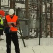 Engineer sign contracts at the electrical substation — Stock Video