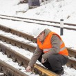 Stock Photo: Railroad worker with adjustable wrench on railroad