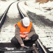 Stock Photo: Railroad worker with adjustable wrench in hand