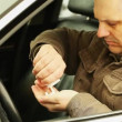 Man in car with drugs in the hand — Stock Video #21072861