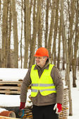 Builder near the building materials in winter — Stock Photo