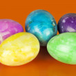 Easter eggs in different colors on an orange background — Stock Photo #21965411
