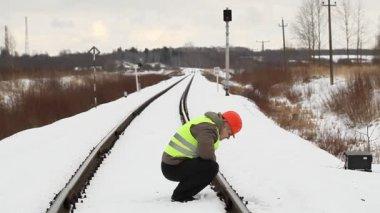 Railroad worker take railway safety inspection — Стоковое видео