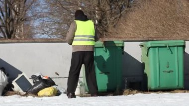Environmental Officer with folder near waste containers — Stock Video