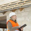 Stock Photo: Construction manager checking new building