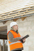 Construction manager checking new building — Stock Photo