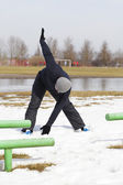 The athlete warmed up at the stadium in winter — Stock Photo