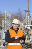 Electrical engineer written documentation near to the electric substations — Stock Photo