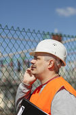 Engineer with a folder in factory site — Stock Photo