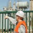 Electrician indicates to the transformer near the electrical substation — Stock Photo
