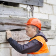 Building inspector near unfinished house — Stock Photo