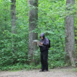 Stock Video: Hiker with map and binoculars on forest trails episode 3