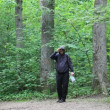 Stock Video: Hiker with map and binoculars on forest trails episode 1