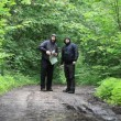 Stock Video: Hikers with map and binoculars on forest trails episode 3