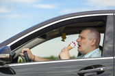 Man eating ice cream while sitting in car — Stock Photo