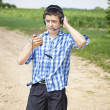 Boy with headphones and Mic on rural road — Stock Photo