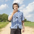 Boy with headphones and Mic on rural road in summer — Stock Photo