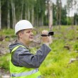 Forest Officer with camcorder filmed deforest — Stock Photo #29691109