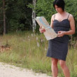 Woman with map and cell phone on the road episode 1 — Stock Video #29691483