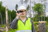 Forest Officer with camcorder in destroyed forest — Stock Photo