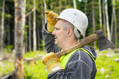 Lumberjack in the forest with an ax — Stock Photo