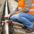 Worker with a coffee on the rail in summer — Stock Photo