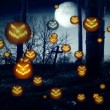Stock Video: Flying pumpkin heads over Cemetery