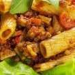 Tortiglioni with sauce bolognese on plate — Stock Photo #33189089
