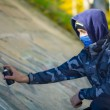 Stock Photo: Teenager with color spray cnear wall