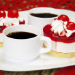 Cherry cakes with coffee on a plate — Stock Photo