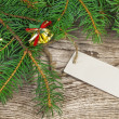 Spruce branches with blank sheet on wood — Stock Photo
