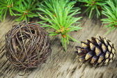 Cone with decorations and fir branches — Stock Photo