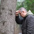 Depressed man leaning on a tree episode 2 — Stock Video