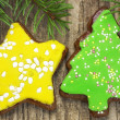 Gingerbreads with spruce branches on wooden table  2 — Stock Photo
