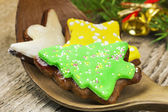 Gingerbreads with spruce branches on wooden table — Stock Photo