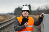 Railroad employee with tablet PC near railway — Stock Photo