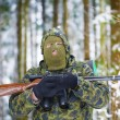 Stock Photo: Hunter with optical rifle and binoculars forest in the winter
