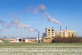 Smoke coming out of the factory chimneys in winter — Stock Photo
