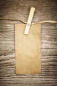 Old paper note on a wooden boards — Stock Photo