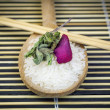 Rice on wooden spoon with wooden chopsticks — Stock Photo