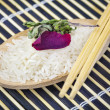 Rice on wooden spoon — Stock Photo